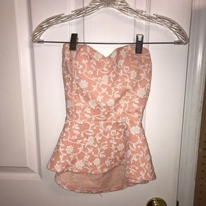 Pink strapless peplum top with bow back